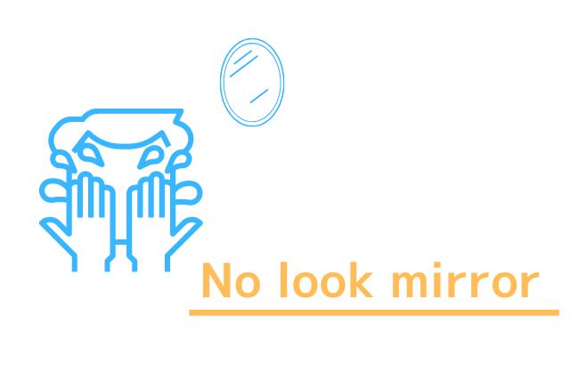 鏡を見ずに洗顔する男性